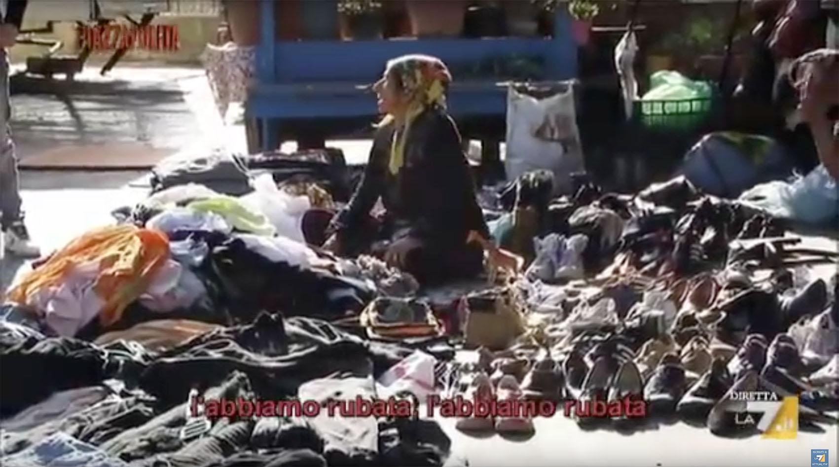 中国 罗马/当记者询问这位妇女这些衣服和鞋子是怎么来的,这位妇女用标准...